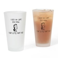 I used to care But now I take a pil Drinking Glass