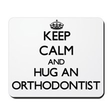 Keep Calm and Hug an Orthodontist Mousepad