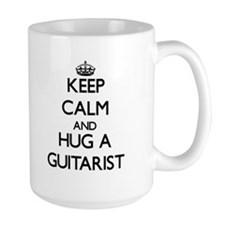 Keep Calm and Hug a Guitarist Mugs