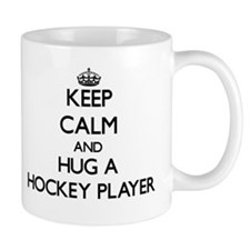 Keep Calm and Hug a Hockey Player Mugs