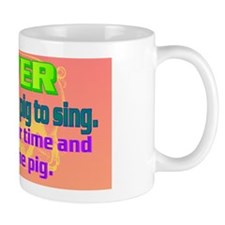 NEVER try to teach a pig to sing(oval l Mug