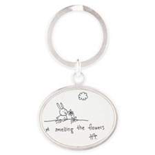 Smelling flowers Oval Keychain