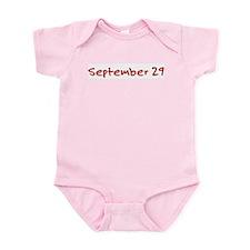 """September 29"" printed on a Infant Bodysuit"