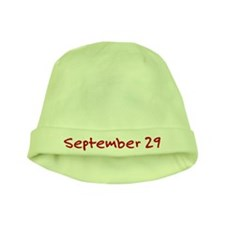 """""""September 29"""" printed on a baby hat"""