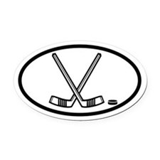 Hockey Sticks and Puck Oval Car Magnet