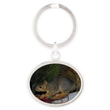 Sledding Squirrel Oval Keychain