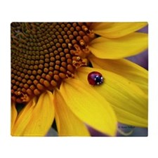 Ladybug on Sunflower Petal Throw Blanket