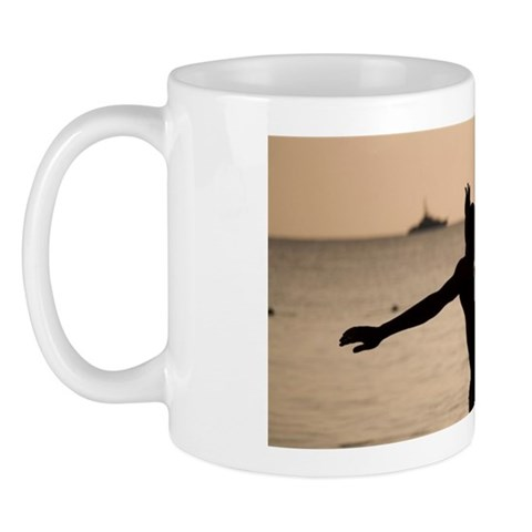 Silhouette of young men playing soccer Mug