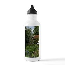 Cottage garden in Spri Water Bottle