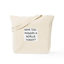 Hugged a Noelle Tote Bag
