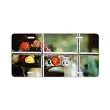 White cat sitting in window Aluminum License Plate