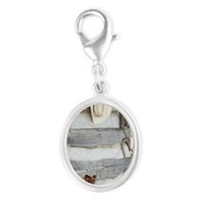 Cowboy boots and hat outside of Silver Oval Charm