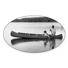 Couple in canoe on lake Decal