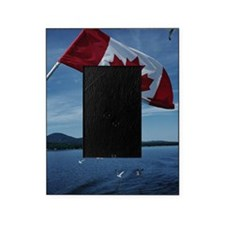 Canadian flag by water Picture Frame
