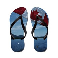 Canadian flag by water Flip Flops