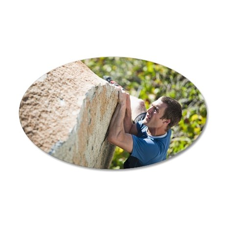 A climber traverses with his 35x21 Oval Wall Decal