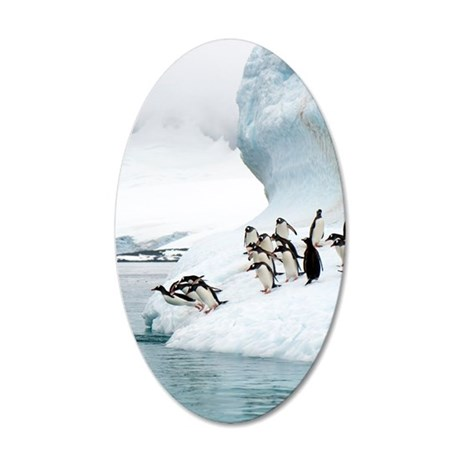 Gentoo penguins jumping into 35x21 Oval Wall Decal
