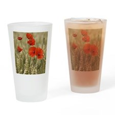 Poppies in a grain field Drinking Glass