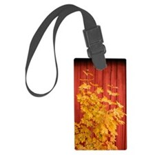Yellow leaves against a red Barn Luggage Tag