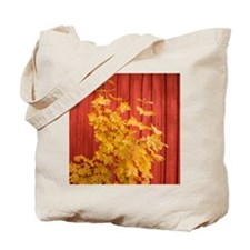 Yellow leaves against a red Barn Tote Bag