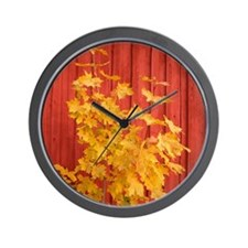 Yellow leaves against a red Barn Wall Clock