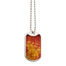 Yellow leaves against a red Barn Dog Tags