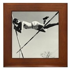 Male pole-vaulter clearing bar Framed Tile