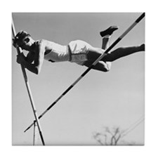 Male pole-vaulter clearing bar Tile Coaster