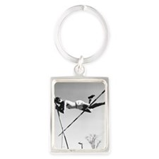 Male pole-vaulter clearing bar Portrait Keychain