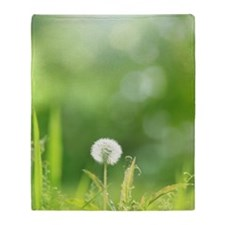 The seed of a dandelion Throw Blanket
