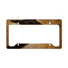 A bear skin rug on wooden flo License Plate Holder