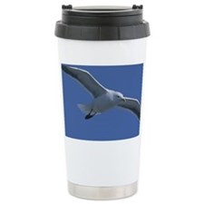 Seagull flying in blue sky Ceramic Travel Mug