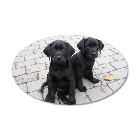 Puppy black Labradors 35x21 Oval Wall Decal