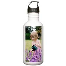 Young girl watering fl Water Bottle