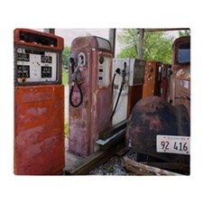 Rusty gas pumps and car Throw Blanket