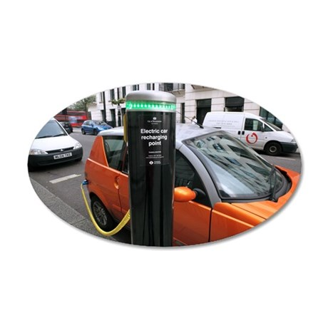 Recharging an electric car 35x21 Oval Wall Decal