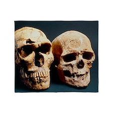 Neanderthal and Cro-Magnon 1 skulls Throw Blanket