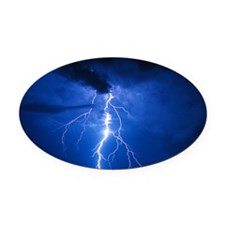 Lightning strikes mountain at nigh Oval Car Magnet