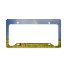 Storm clouds and rainbow over License Plate Holder