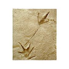 Dinosaur footprint fossils Throw Blanket