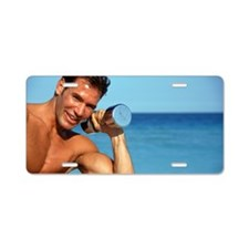 Man holding weights on beac Aluminum License Plate