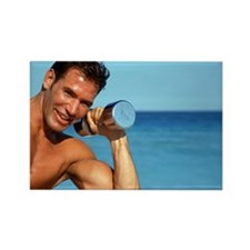 Man holding weights on beach, smi Rectangle Magnet