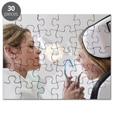 Dentist with patient in surgery Puzzle