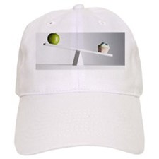Cupcake tipping seesaw with green apple on end Baseball Cap