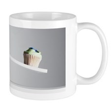 Cupcake tipping seesaw with green apple Mug