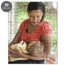 Mother breast feeding child Puzzle