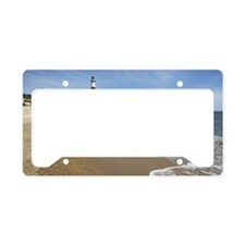 Beach with lighthouse in back License Plate Holder