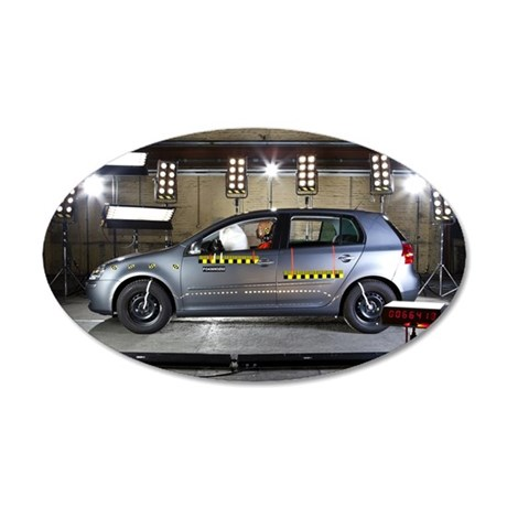 A car with a crash test dumm 35x21 Oval Wall Decal