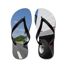 Transport truck on highway Flip Flops