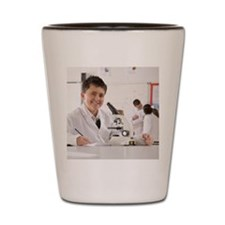 Student with microscope in school labor Shot Glass